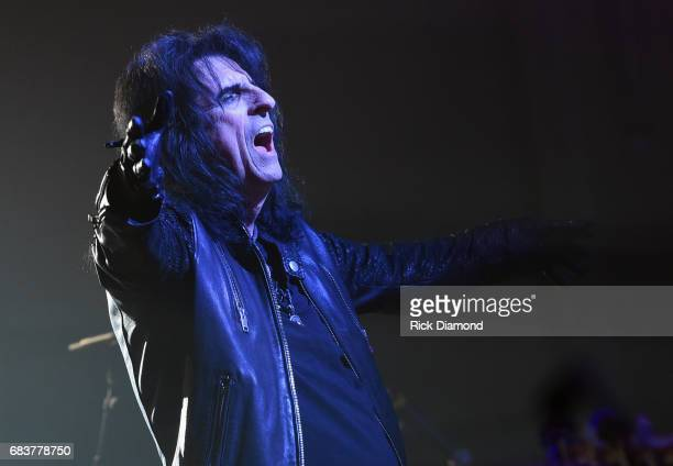 Rock Roll Hall of Fame Singer/Songwriter Alice Cooper performs with 3 original band members Michael Bruce Dennis Dunaway and Neal Smith during Music...