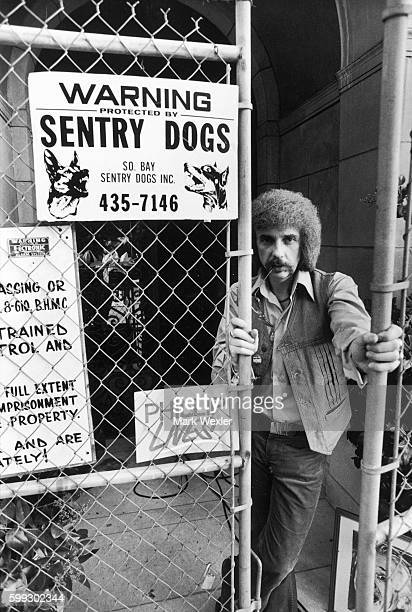 Rock Roll songwriter and record producer Phil Spector peers through the fence gates at his Beverly Hills estate On February 3 Phil Spector age 62...