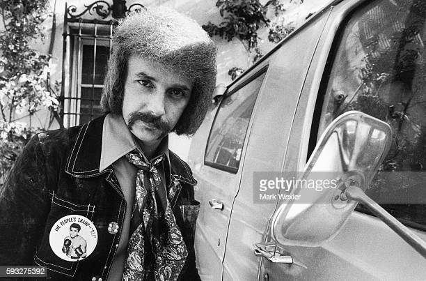 Rock Roll songwriter and record producer Phil Spector stands next to his vehicle On February 3 Phil Spector age 62 known for his creation of the...