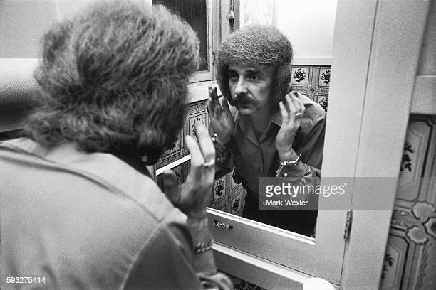 Rock Roll songwriter and record producer Phil Spector styles his hair in the bathroom of his Beverly Hills estate On February 3 Phil Spector age 62...