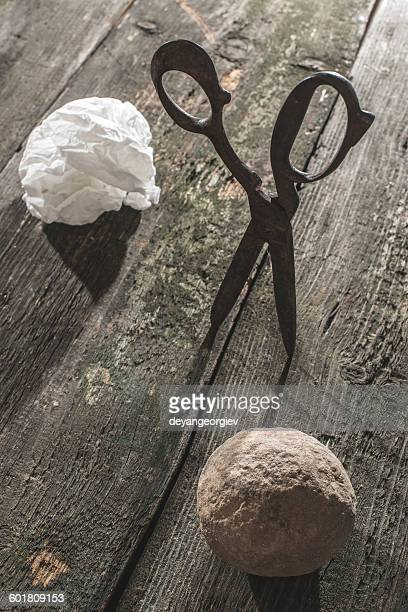 Rock, scissors and paper on wooden table