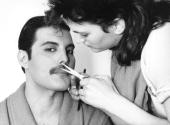 Rock singer Freddie Mercury of the popular British group Queen has his moustache groomed