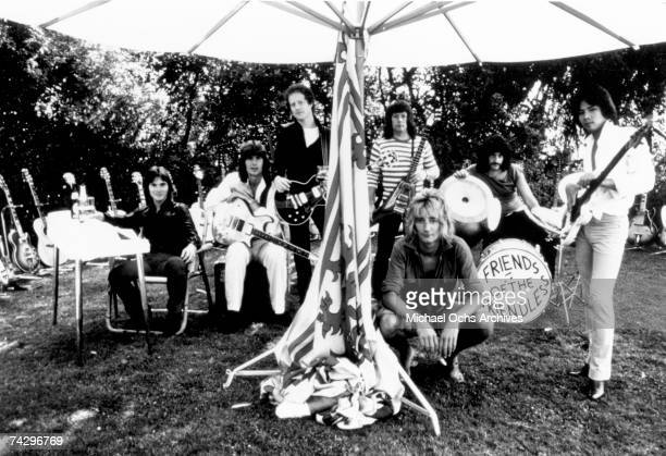 Rock singer Rod Stewart poses for a portrait with his band and a kick drum that reads 'Friends Of The Friendless' John Jarvis Gary Grainger Jim...