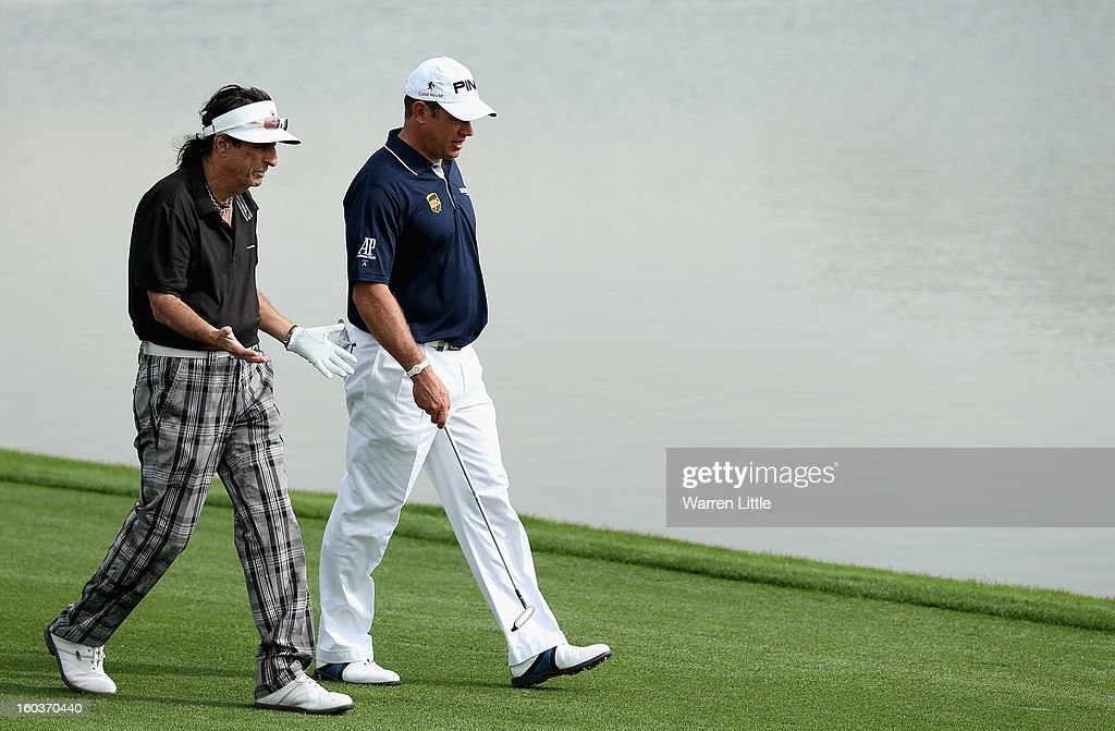 Rock Star, Alice Cooper and Lee Westwood of England walk down the ninth fairway during the pro-am of the Omega Dubai Desert Classic at Emirates Golf Club on January 30, 2013 in Dubai, United Arab Emirates.