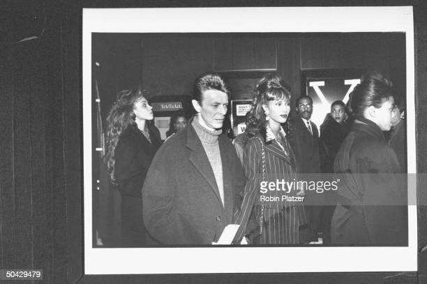 Rock star David Bowie arriving w his model wife Iman at theater for a screening of the movie Malcolm X
