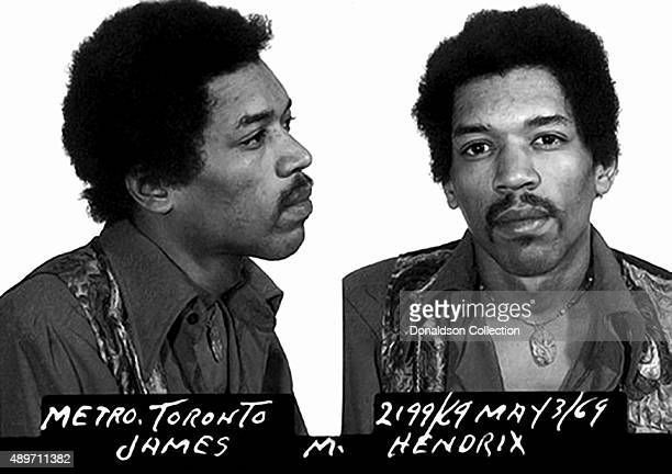 Rock star Jimi Hendrix poses for a mugshot after his arrest for narcotics possession at Toronto International Airport on May 3 1969 in Toronto...