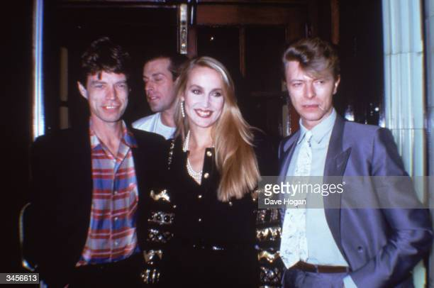 Rock star Mick Jagger with his girlfriend fashion model Jerry Hall and singer David Bowie 1984