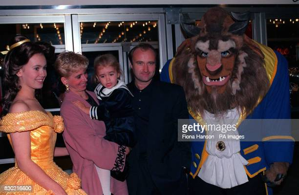 Rock star Phil Collins with his wife Jill and their 3 year old daughter Lily who was overawed by the Beast of Walt Disney's Beauty and the Beast at...