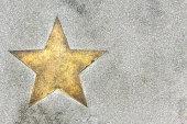 bronze plate star on concrete floor