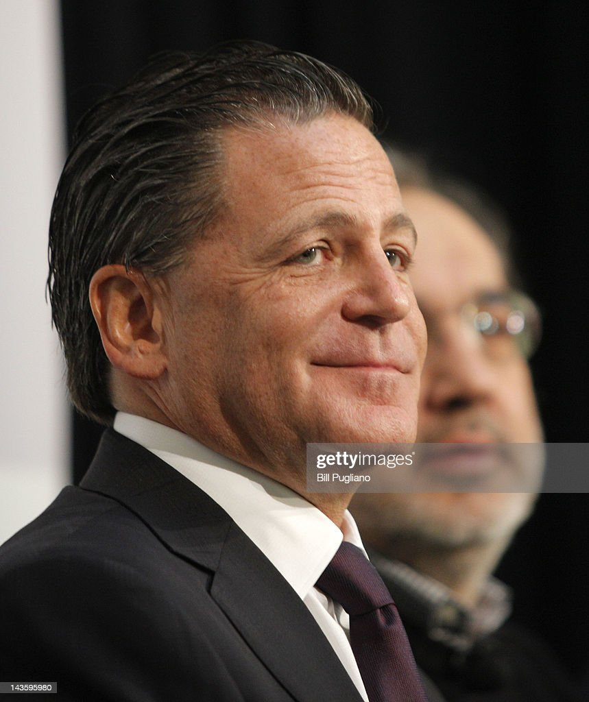 Rock Ventures and Quicken Loans Chairman Dan Gilbert (L) and Chrysler Group Chairman and CEO <a gi-track='captionPersonalityLinkClicked' href=/galleries/search?phrase=Sergio+Marchionne&family=editorial&specificpeople=608333 ng-click='$event.stopPropagation()'>Sergio Marchionne</a> announce that Chrysler will have an office presence in downtown Detroit for the first time April 30, 2012 in Detroit, Michigan.The Chrysler Group will be renaming the Rock Ventures Historic Dime Building the 'Chrysler House'.