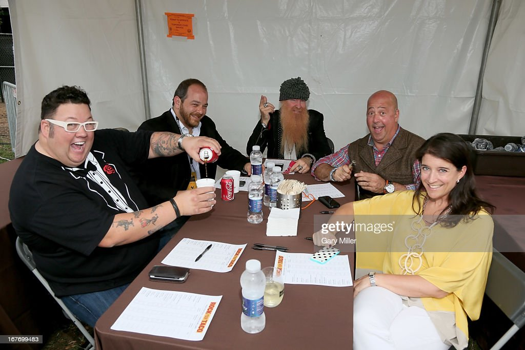 Rock Your Taco judges Graham Elliot, Andy Langer, <a gi-track='captionPersonalityLinkClicked' href=/galleries/search?phrase=Billy+Gibbons&family=editorial&specificpeople=242873 ng-click='$event.stopPropagation()'>Billy Gibbons</a>, <a gi-track='captionPersonalityLinkClicked' href=/galleries/search?phrase=Andrew+Zimmern&family=editorial&specificpeople=4525179 ng-click='$event.stopPropagation()'>Andrew Zimmern</a> and Christina Gordavic at the judges table during the Austin Food & Wine Festival at Republic Square Park on April 27, 2013 in Austin, Texas.