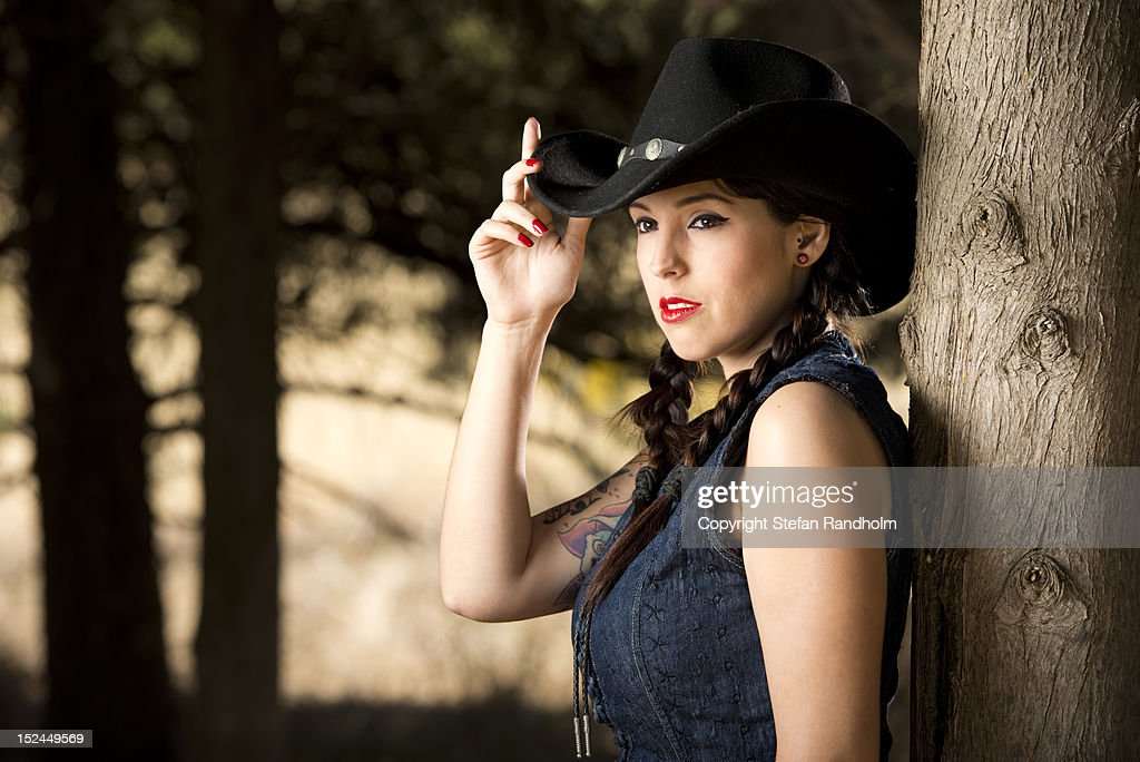 Rockabilly girl with cowboy hat : Stock Photo