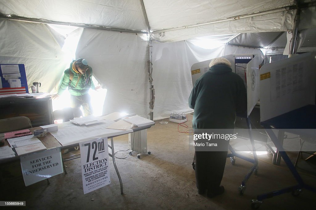 A Rockaway resident marks her ballot in a makeshift tent set up as a polling place at Scholars' Academy, PS 180, in the Rockaway neighborhood on November 6, 2012 in the Queens borough of New York City. The Rockaway section of Queens was one of the hardest hit areas and O'Quinn's home is damaged. Many voters in New York and New Jersey are voting at alternate locations in the presidential election due to disruption from Superstorm Sandy.