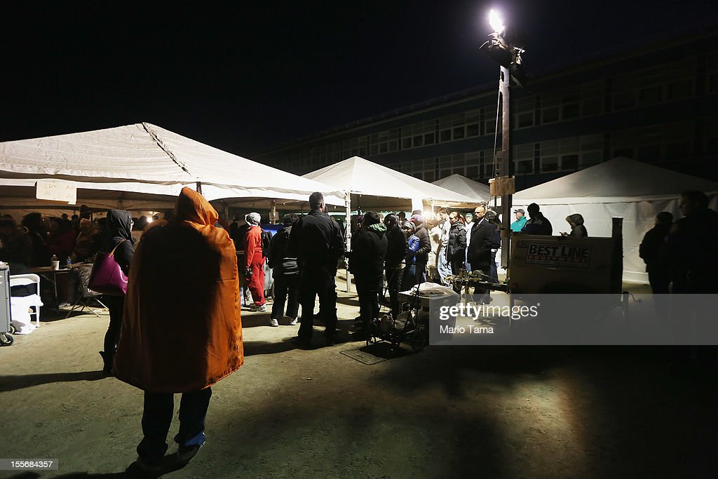 Rockaway residents wait in line to cast their ballots in an unheated makeshift tent set up as a polling place at Scholars' Academy, PS 180, in the Rockaway neighborhood on November 6, 2012 in the Queens borough of New York City. The Rockaway section of Queens was one of the hardest hit areas. Many voters in New York and New Jersey are voting at alternate locations in the presidential election due to disruption from Superstorm Sandy.
