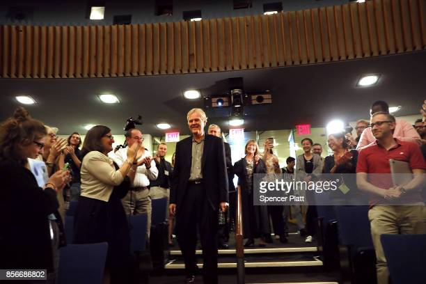 Rockefeller University biologist Michael Young is congratulated by students and faculty after winning the Nobel Prize in Physiology on October 2 2017...