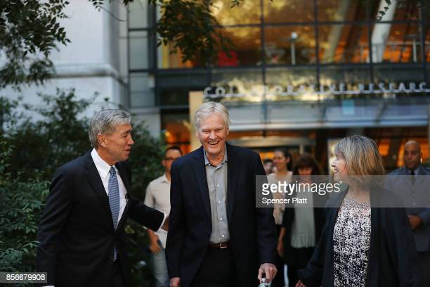 Rockefeller University biologist Michael Young walks on campus with his wife Laurel Eckhardt and university president Richard Lifton after winning...