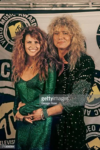 Rocker David Coverdale of the rock group 'Whitesnake' poses with his girlfriend Tawny Kitaen at the 1987 MTV Music Awards at Universal City...