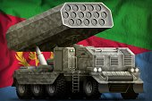 rocket artillery, missile launcher with grey camouflage on the Eritrea flag background. 3d Illustration