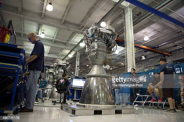 LOS Rocket engineers and technicians gather around a Merlin 1D rocket engine on the factory floor at SpaceX on October 21 2013 in Los Angeles Ca