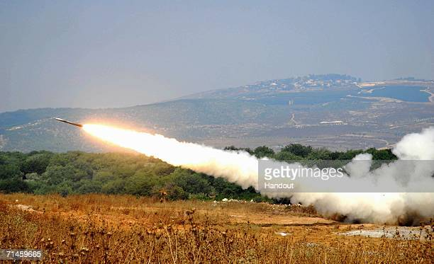A rocket fired by a Multiple Launch Rocket System is launched against an Hezbollah target in South Lebanon July 16 2006 from a forward base on the...
