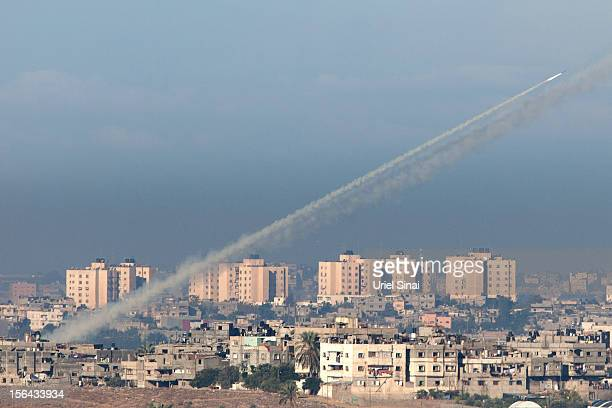 A rocket is launched from Gaza as seen from Sderot on November 15 2012 in Israel A rocket attack on an apartment building in Kiryat Malachi Israel...