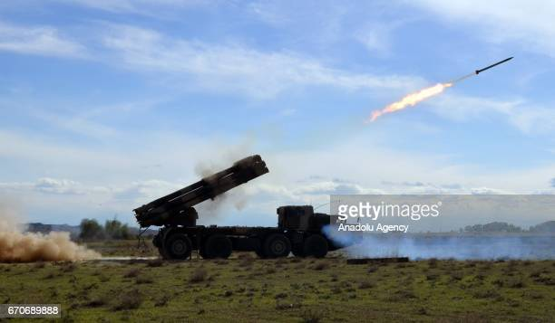 A rocket launcher vehicle belonging to Azarbaijani army launches a rocket during a large scale exercise in Baku Azarbaijan on April 20 2017...
