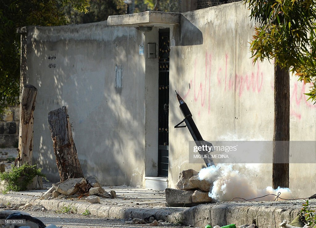 A rocket prepared by rebel forces is launched in the Saif al-Dawla district of the northern Syrian city of Aleppo, on April 21, 2013. Syria's National Coalition head Ahmad Moaz al-Khatib has refiled his resignation and an interim leader is being sought, a fellow member and a source close to the main opposition group said.