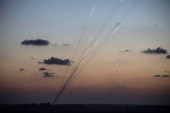 Rockets are fired from inside the Gaza strip towards Israel on the sixth day of Israel's operation 'Protective Edge' on July 13 2014 as seen from...
