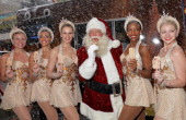 Rockettes Tara Dunleavy Tubridy Nicole Baker Luftig Melinda Farrell Santa Claus Danelle Morgan Dani Betchel and Traci Reszetylo pose for a picture as...