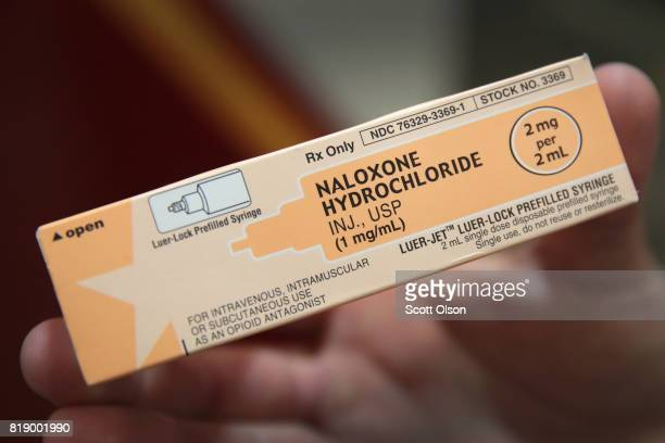 Rockford firefighter displays a dose of Naloxone which the department carries on their ambulances to treat opioid drug overdoses on July 14 2017 in...