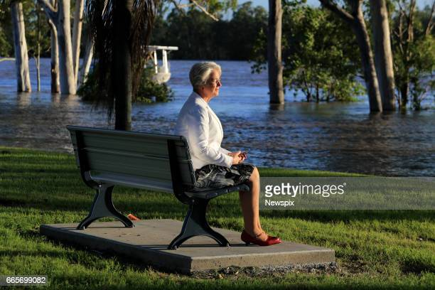 ROCKHAMPTON QLD Rockhampton MAYor Margaret Strelow watches the rising floodwaters at Depot Hill in Rockhampton Queensland after the Fitzroy River...