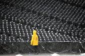 Rockies field person sticks it out on the field at the Colorado Rockies game at Coors field as a huge thunder and rain storm passes through the metro...