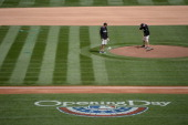 Rockies grounds crew touches up the field before the game The Colorado Rockies hosted the Arizona Diamondbacks in the Rockies season home opener at...