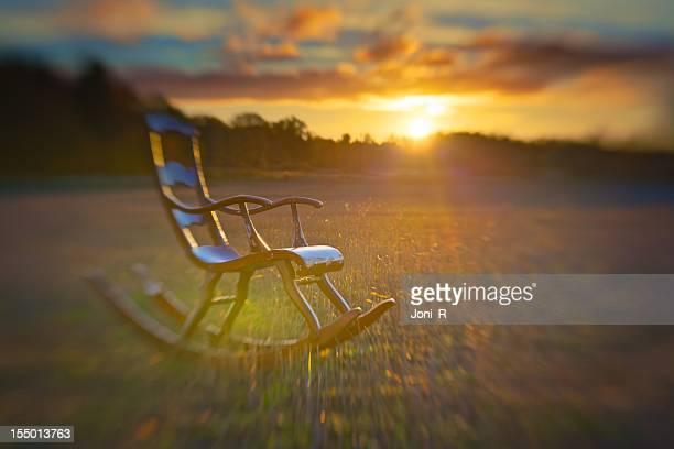Cadeira de Embalar em nascer do sol de Campo
