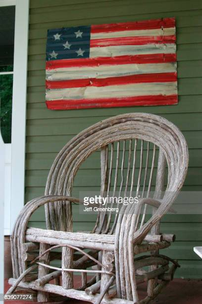 A rocking chair outside a house in Round Hill