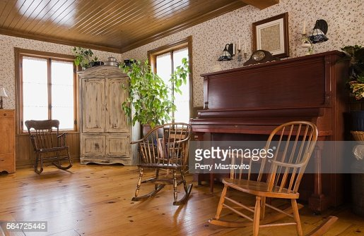 Rocking chairs and piano in the living room of house : Stock Photo - Rocking Chairs And Piano In The Living Room Of House Stock Photo