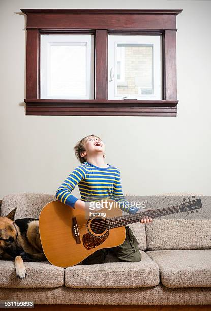 Rocking out on the couch with a guitar