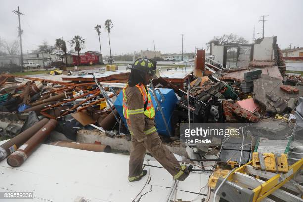Rockport firefighter goes door to door on a search and rescue mission as he looks for people that may need help after Hurricane Harvey passed through...