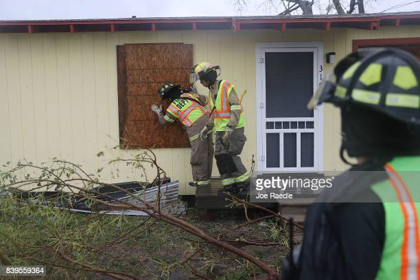 Rockport firefighters go door to door on a search and rescue mission as they look for people that may need help after Hurricane Harvey passed through...