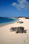 Rocks and sand on the beach at Georgetown on Ascension Island, Mid Atlantic