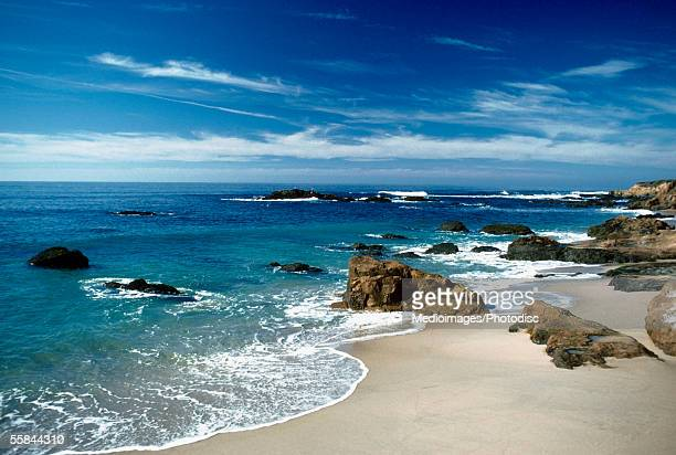 Rocks at a coastline of a sea, Bean Hollow Beach, Highway 1, California, USA
