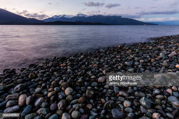 Rocks near remote riverbed under mountains, Te Anau, Southland, New Zealand
