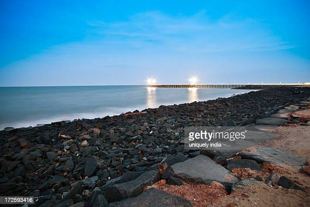 Rocks on beach at dusk, Pondicherry, India