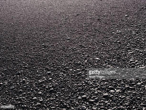 Rocks on black sands