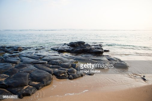 Rocks on hawaiian beach : Stock Photo