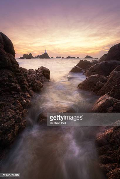 Rocks overlooking distant lighthouse