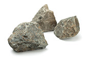 Three pieces of raw rocks isolated on white