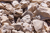 Rocks, small rocks or gravel Used for construction of buildings, roads and for landscaping.