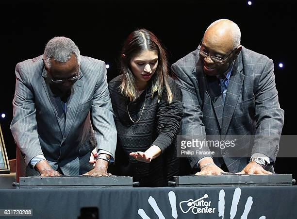 Rockwalk inductees Clyde Stubblefield and John 'Jab'o' Starks and Guitar Center's Jamesina Rammelkamp perform the handprint ceremony onstage during...