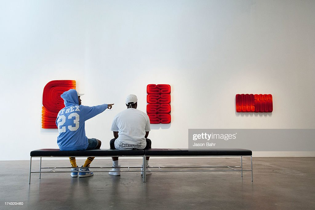 Rocky (L) and A$AP Ferg appreciate the displayed art during a filming for Music Choice's Take Back Your Music Campaign at Robischon Gallery on July 23, 2013 in Denver, Colorado.
